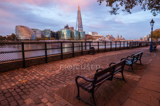 Scenic view from North Bank of River Thames looking south, waterfront with Shard skyscraper, London, UK — Stock Photo