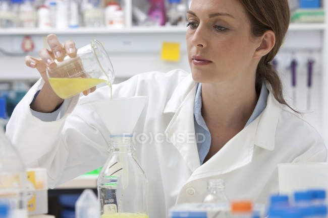 Portrait of confident mid adult caucasian woman at work in laboratory — Stock Photo