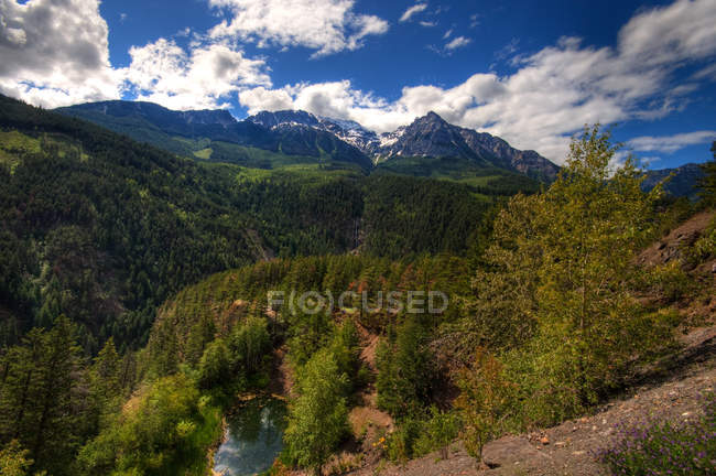 Scenic view of beautiful mountain range under cloudy sky — Stock Photo