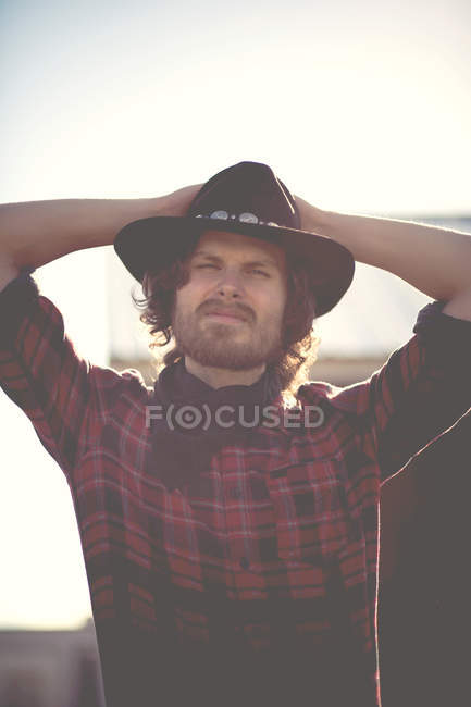 Portrait of modern cowboy wearing shirt and hat — Stock Photo