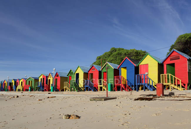 South Africa, Cape Town, St Jame's Beach, Muizenberg, Row of multi colored beach houses — Stock Photo