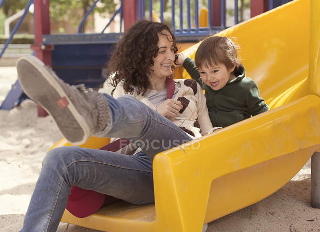Mother and son relaxing in playground — Stock Photo