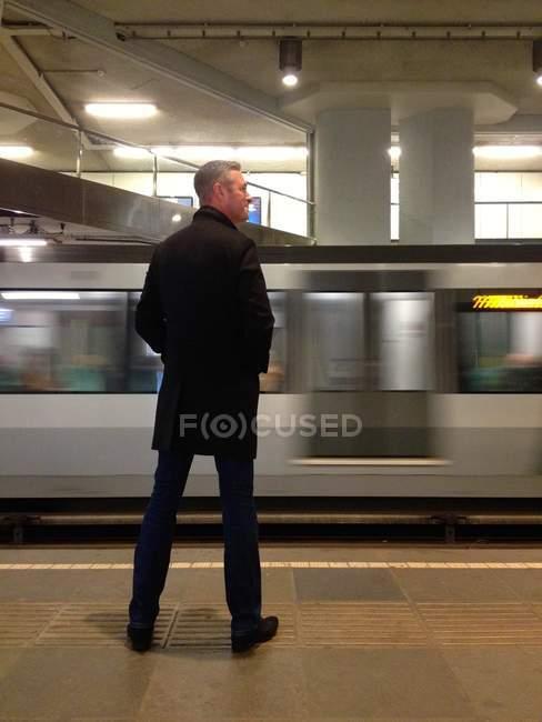Mature man waiting for train on subway platform — Stock Photo