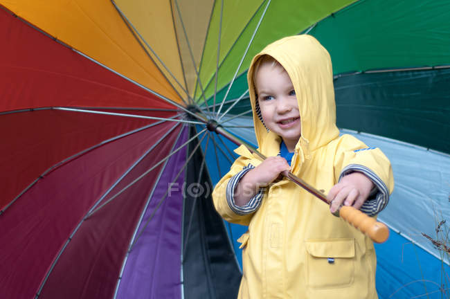 Portrait of Boy holding colorful umbrella — Stock Photo
