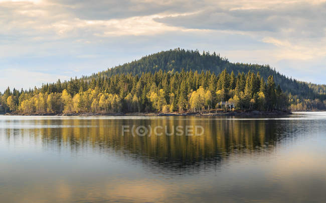 Scenic view of reflection of hill in lake, Norway — Stock Photo