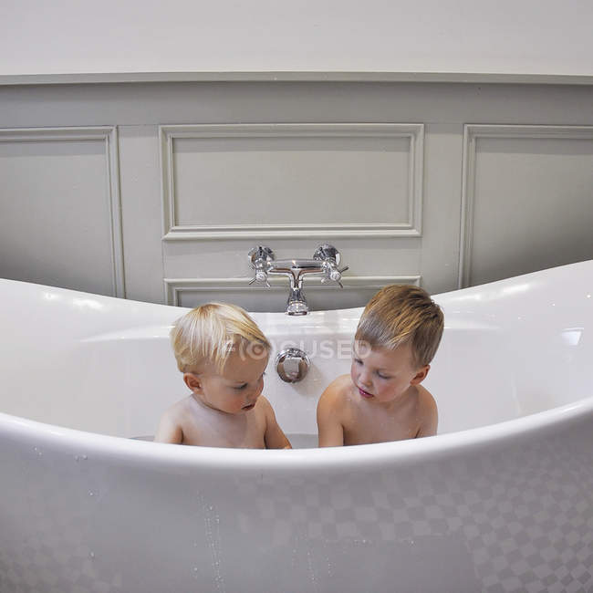 Two cute little brothers in bathroom together — Stock Photo