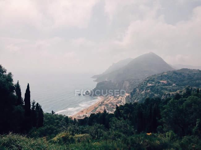 Mountainous coastline with sandy beach, Corfu, Greece — Stock Photo