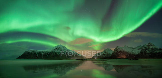 Green milky way and lake water — Stock Photo