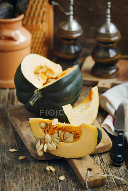 Preparing fresh pumpkin for cooking at kitchen — Stock Photo