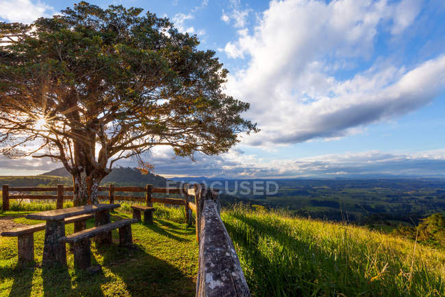 Rural landscape view with bench under tree, Atherton Tableland, Cairns, Queensland, Australia — Stock Photo