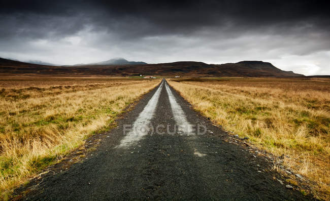 Scenic view of empty straight road, Iceland — Stock Photo