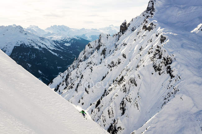 Man Skiing in snow covered mountains, Austria — Stock Photo