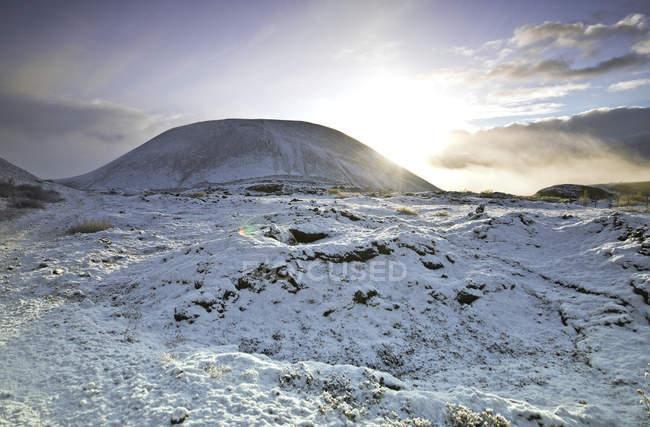 Volcano in winter landscape, Grabrok, Iceland — Stock Photo