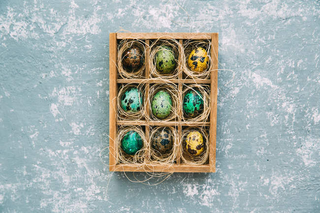 Top view of easter eggs in a wooden box — Stock Photo