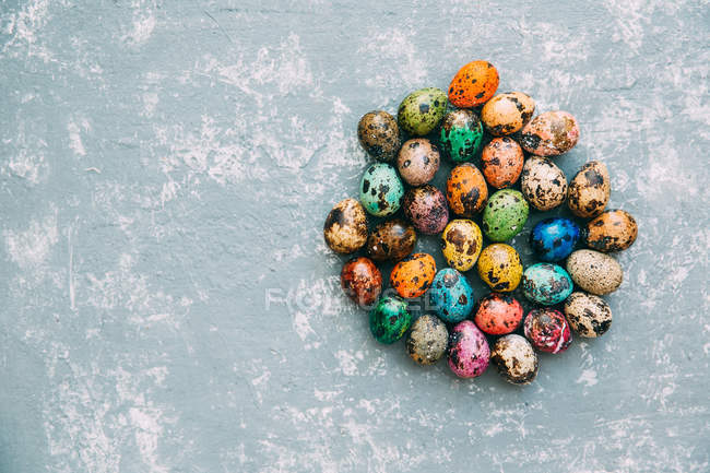 Multi-colored Easter eggs over weathered background — Stock Photo