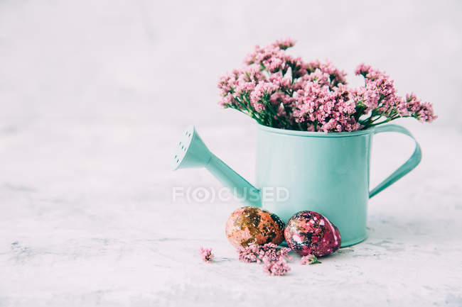 Closeup view of watering can with flowers — Stock Photo