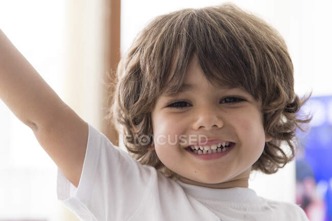 Portrait of smiling boy at home looking at camera — Photo de stock
