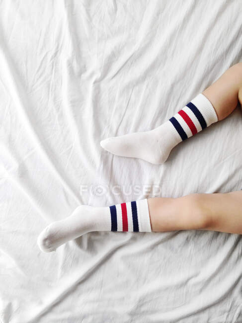 Close-up of a boy's feet and socks — Stock Photo