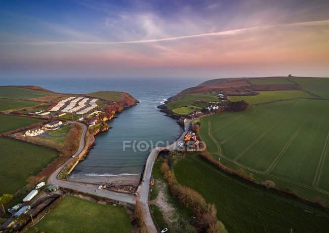 Roberts Cove au coucher du soleil, Munster, Irlandevue panoramique de — Photo de stock