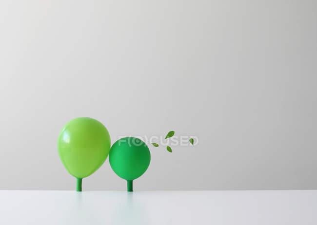 Conceptual green balloons as trees — Stock Photo