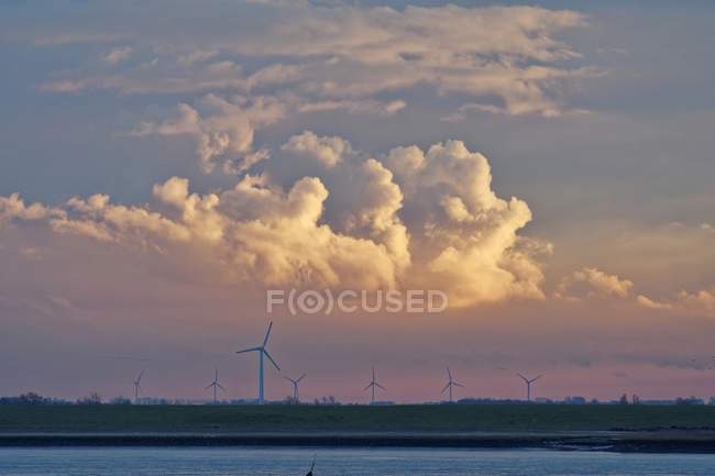 Wind turbines along River Ems, Lower Saxony, Germany — Stock Photo