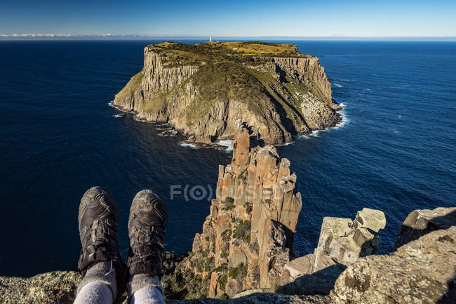 Cropped image of woman sitting on The Blade, Cape Pillar, Tasmania, Australia — Stock Photo
