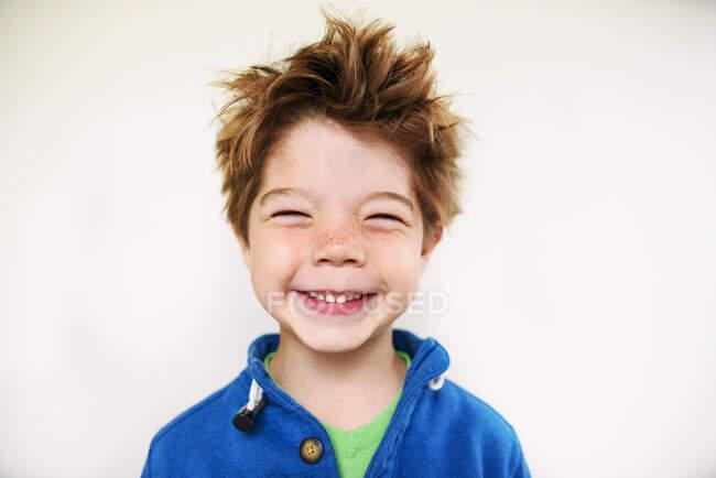 Close-up portrait of smiling boy isolated on white — Stock Photo