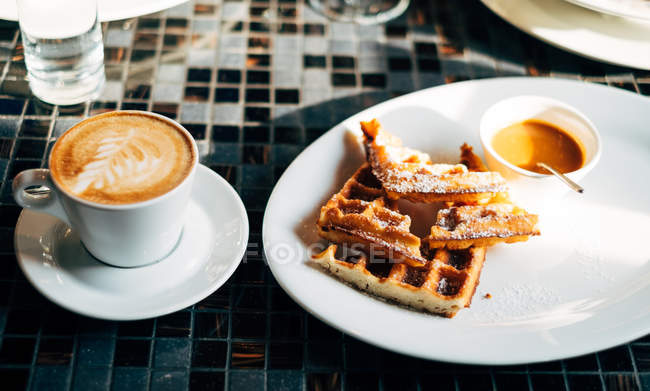 Tasty waffles and coffee, breakfast conception — Stock Photo