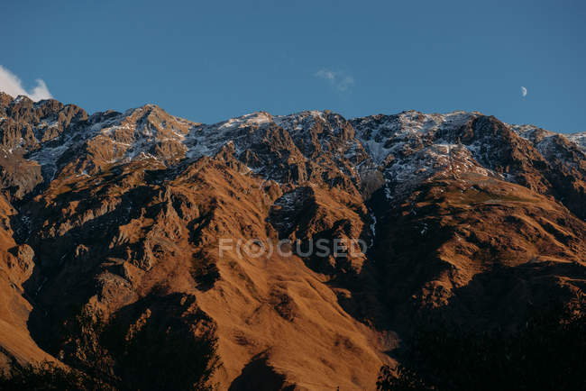 Scenic view of majestic mountains under blue sky — Stock Photo