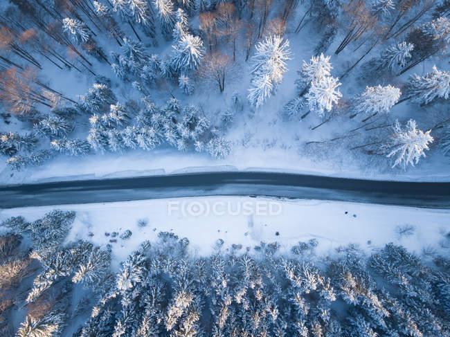 Aerial view of a road through winter landscape, Gaisberg, Salzburg, Austria — Stock Photo