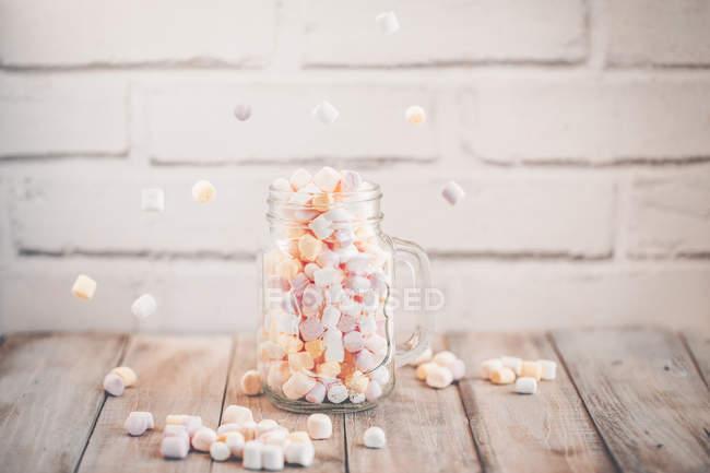 Mason jar filled with miniature, marshmallows — Stock Photo