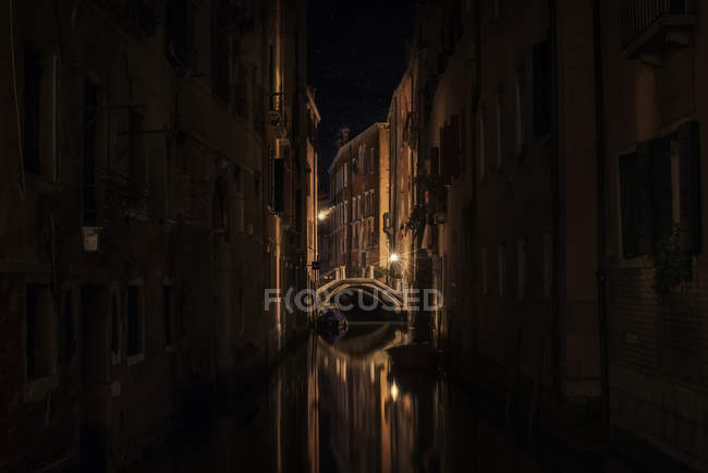 Scenic view of Venetian Canal at night, Venice, Italy — Stock Photo