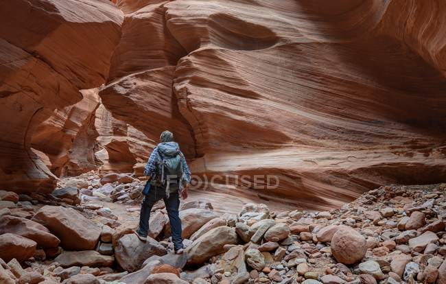 Rear view of Man hiking, Happy Slot Canyon, San Rafael Desert near Hanksville, Utah, United States — стокове фото