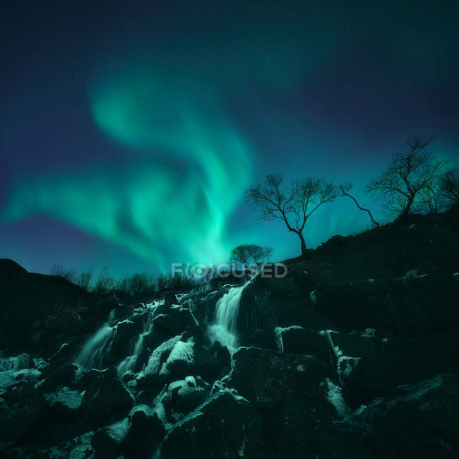 Scenic view of Northern lights over waterfall, Lofoten, Norway — Stock Photo