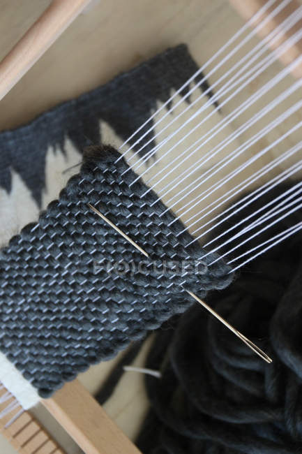 Closeup view of the handmade scarf knitting — Stock Photo