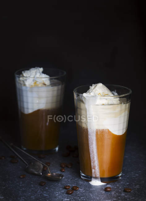 Iced coffee in a tall glass with ice cream — Stock Photo