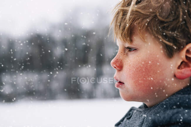 Portrait of a boy standing in the snow — Stock Photo