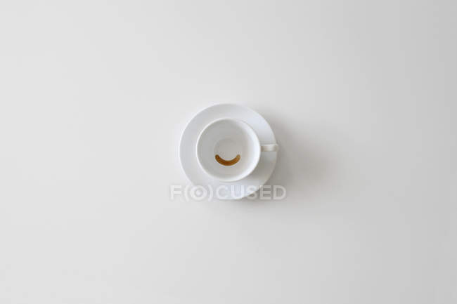 Conceptual smiley face by cup and coffee — Stock Photo