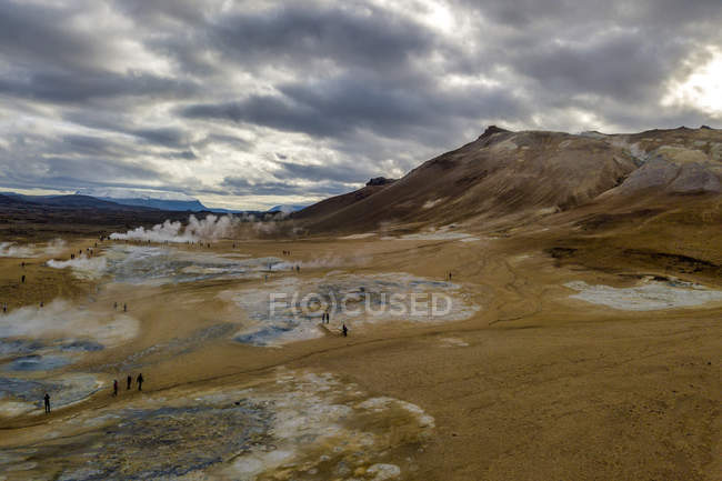 Tourists visiting Hverir Geothermal Area, Northeast Iceland — Stock Photo