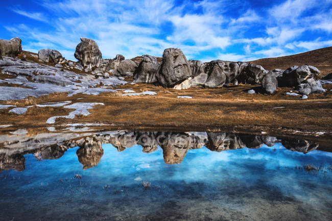 Scenic view of Rock reflections in a puddle of water, Castle Hill, South Island, New Zealand — Stock Photo