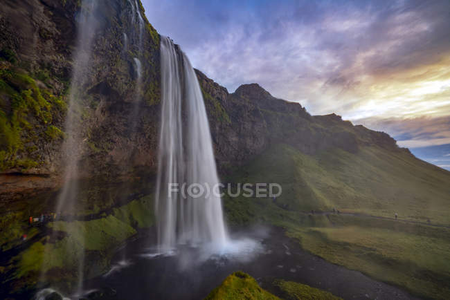 Scenic view of Seljalandsfoss at sunset, South Iceland — Stock Photo