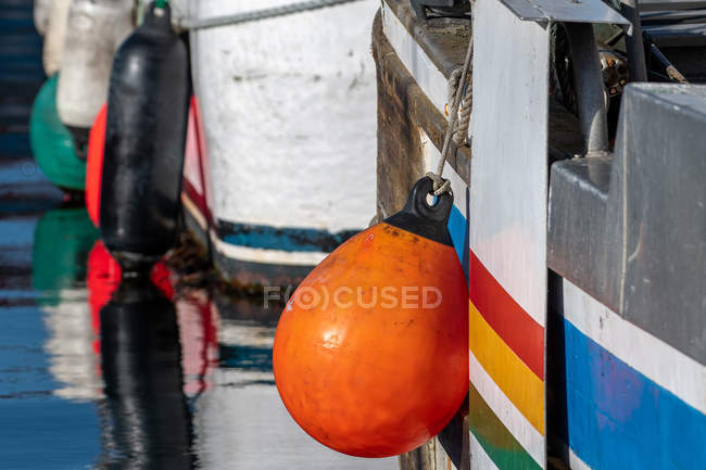 Floats hanging on boats in a harbor — Stock Photo