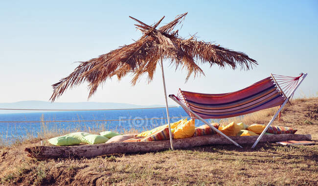 Hammock under a parasol on beach, Bulgaria — Stock Photo