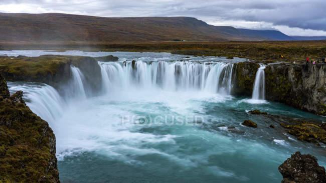 Scenic view of beautiful Godafoss waterfall at sunset, Bardardalur, Iceland — Stock Photo