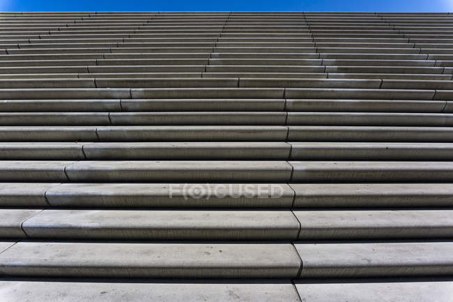 Full Frame Close-Up of Stairs at Landungsbrucken Against Blue Sky — Stock Photo