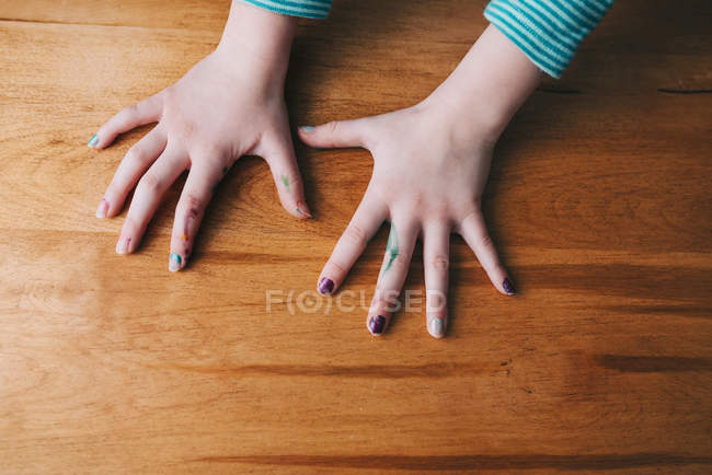 Girl's hands with nail polish and marker pen — Stock Photo