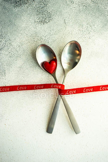 Red and white hearts on a wooden background — Stock Photo
