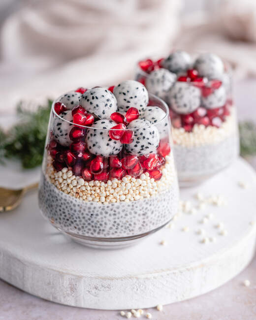 Two Chia pudding desserts with puffed quinoa, pomegranate and dragon fruit balls — Stock Photo