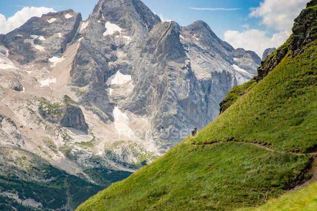 Man and woman mountain biking in the Dolomites, Italy — Stock Photo