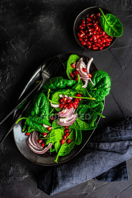 Healthy food concept with fresh organic spinach leaves salad on rustic background with copy space — Stock Photo